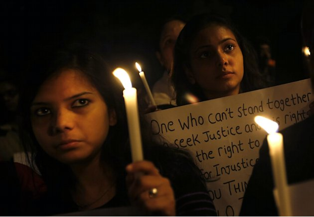 Indian students participate in a candlelight vigil to mark the passing of a month since a gang rape of a 23-year-old student in a bus, in New Delhi, India, Wednesday, Jan. 16, 2013. The bus rape has d