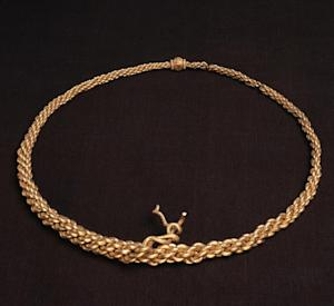 """This photo released by the British Museum on Thursday Sept. 26, 2013, shows a 10th century neck-ring made of gold. The biggest Viking ship ever found is coming to London as part of a major exhibition that aims to expand the popular image of the Scandinavian plunderers, whose voyages took them as far as Asia and North America. The 1,000-year-old, 37-meter (120-foot) wooden longboat discovered on the banks of a fjord in Roskilde, Denmark, in 1997 is the centerpiece of """"Vikings: Life and Legend,"""" which opens at the British Museum in March. (AP Photo/British Museum)"""