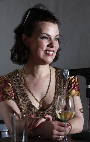 "Actress and food blogger Debi Mazar laughs during a panel discussion called ""Girls Gone Wild"" about women in the celebrity cooking world at the South Beach Wine and Food Festival, Saturday, Feb. 25, 2012 in Miami.  (AP Photo/Carlo Allegri)"