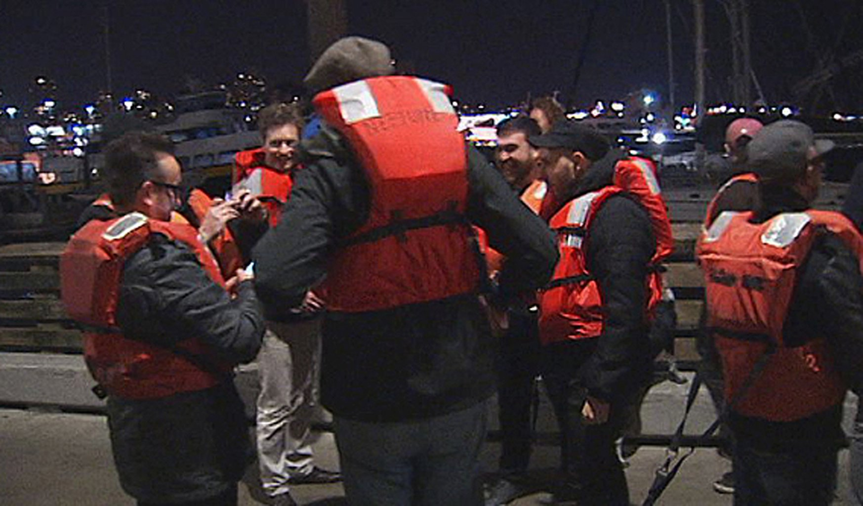 22 rescued passengers on the pier Friday Oct.12, 2012 in San Francisco. A U.S. Coast Guard spokesman said the wine-tasting boat