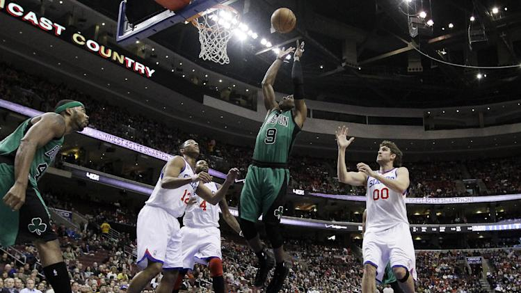 Boston Celtics' Rajon Rondo, center, goes up for a rebound as Philadelphia 76ers' Evan Turner, from left, Dorell Wright and Spencer Hawes look on during the first half of an NBA basketball game, Friday, Dec. 7, 2012, in Philadelphia. (AP Photo/Matt Slocum)