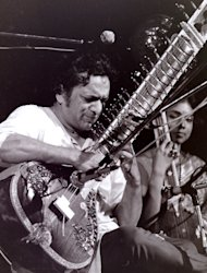 This August 1969 photo provided by Mark Goff shows Ravi Shankar performing at the Woodstock music festival in Woodstock, N.Y. Shankar, who is credited with connecting the world to Indian music, died Tuesday, Dec. 11, 2012 in San Diego at the age of 92. (AP Photo/Mark Goff) MANDATORY CREDIT