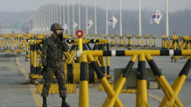A South Korean army soldier uses his radio at Unification Bridge, which has been barricaded, near the border village of Panmunjom, that has separated the two Koreas since the Korean War, in Paju, north of Seoul, South Korea, Monday, April 8, 2013. A top South Korean national security official said Sunday that North Korea may be setting the stage for a missile test or another provocative act with its warning that it soon will be unable to guarantee diplomats' safety in Pyongyang. But he added that the North's clearest objective is to extract concessions from Washington and Seoul. (AP Photo/Lee Jin-man)
