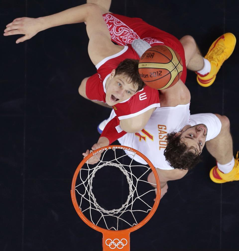 Spain's Pau Gasol, right, and Russia's Timofey Mozgov look up for a rebound during a men's semifinals basketball game at the 2012 Summer Olympics, Friday, Aug. 10, 2012, in London. (AP Photo/Charles Krupa)