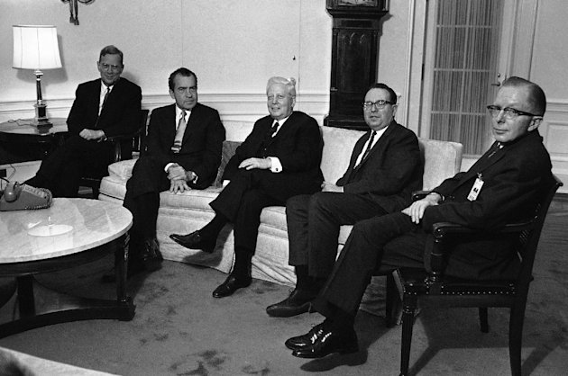 "FILE - In this Jan. 23, 1969 file photo, President Richard Nixon, second from left, poses at the White House in Washington, with four government officials he named as his economic ""Quadriad."" From left are: Chairman William M. Chesney Martin Jr., of the Federal Reserve Board; Nixon; Secretary of the Treasury David M. Kennedy; Budget Director Robert Mayor and Chairman Paul McCracken of the Council of Economic Advisers. McCracken, right, a former economic adviser to several U.S. presidents, has died at age 96. Retired University of Michigan business professor and longtime friend Herbert Hildebrandt says he was told Friday, Aug. 3, 2012, of McCracken's death by Linda Langer, one of McCracken's daughters. (AP Photo/ Harvey Georges, File)"