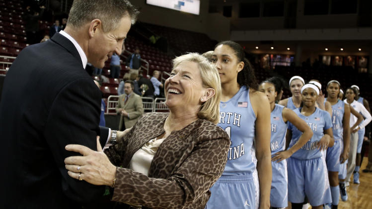 North Carolina coach Sylvia Hatchell is congratulated by Boston College coach Erik Johnson after recording her 900th career win, in North Carolina's 80-52 win over Boston College in an NCAA college basketball game in Boston on Thursday, Feb. 7, 2013. (AP Photo/Winslow Townson)