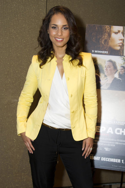 "Singer and filmmaker Alicia Keys attends the premiere of the Showtime documentary ""Keep a Child Alive with Alicia Keys"", in New York, Tuesday, Nov. 29, 2011. (AP Photo/Charles Sykes)"