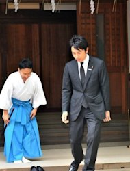 Shinjiro Koizumi (R), Japanese lawmaker and son of former Prime Minister Junichiro Koizumi, leaves the controversial Yasukuni shrine after honouring the dead on the 67th anniversary of Japan&#39;s surrender in World War II, in Tokyo, on August 15