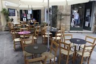 <p>A man sits at an empty coffee shop in Old Nicosia in the Cypriot capital on June 22. By a cruel twist of fate Cyprus is poised to take the chair as EU president tasked with guiding Europe out of financial chaos just as it becomes the fifth eurozone state to seek a Brussels bailout.</p>