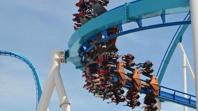 This May 9, 2013 photo released by Cedar Point shows riders testing the new, $30 million winged rollercoaster called GateKeeper at Cedar Point park in Sandusky, Ohio. GateKeeper is designed to mimic flight. It's two-minutes, 40-seconds of flips, drops and spirals. Two of the park's old rides, Disaster Transport and the Space Spiral, were taken down to make way for GateKeeper. The park opens for the season on Saturday. (AP Photo/Cedar Point)