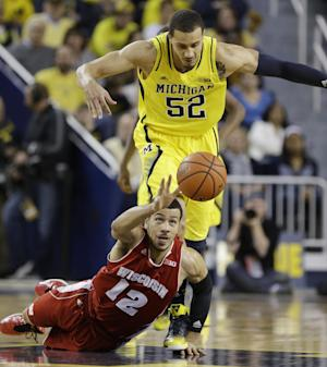 No. 21 Wisconsin beats No. 15 Michigan 75-62