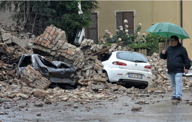 A man looks at the damage caused by a quake in Finale Emilia northern Italy, Sunday, May 20. 2012. An earthquake shook northern Italy early Sunday at 4:04 a.m. Sunday between Modena and Mantova, about