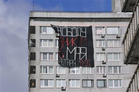 "A banner that reads ""Freedom of prisoners on May 6"" is seen in Moscow, May 6, 2013. REUTERS/Anton Stekov"
