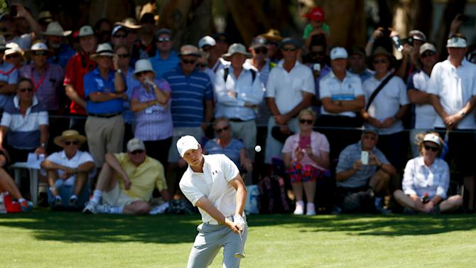 Members of the crowd watch as U.S. golfer Jordan Spieth hit a shot during the first round of the Australian Open golf tournament at the Australian Golf Club in Sydney, Australia