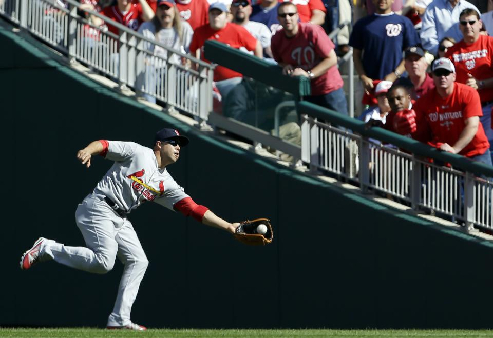 St. Louis Cardinals right fielder Carlos Beltran catches a fly ball that was hit by Washington Nationals' Jayson Werth in the third inning of Game 3 of the National League division baseball series on Wednesday, Oct. 10, 2012, in Washington. (AP Photo/Pablo Martinez Monsivais)
