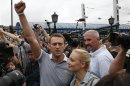 Russian protest leader Alexei Navalny addresses his supporters after arriving from Kirov at a railway station in Moscow