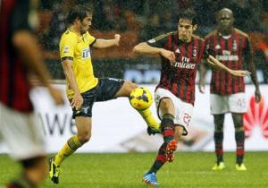 AC Milan's Kaka fights for the ball with Lazio's Alvaro Gonzalez during their Italian Serie A soccer match at San Siro stadium in Milan