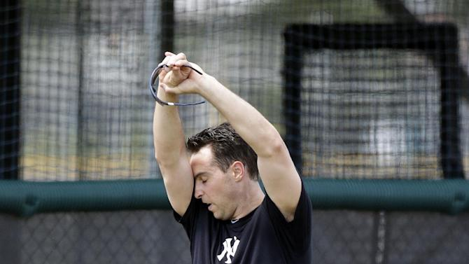 New York Yankees first baseman Mark Teixeira wipes his forehead during rehab workouts at the Yankees Minor League complex Monday, May 6, 2013 in Tampa, Fla. Teixeira is making progress towards his return from a wrist injury. (AP Photo/Chris O'Meara)