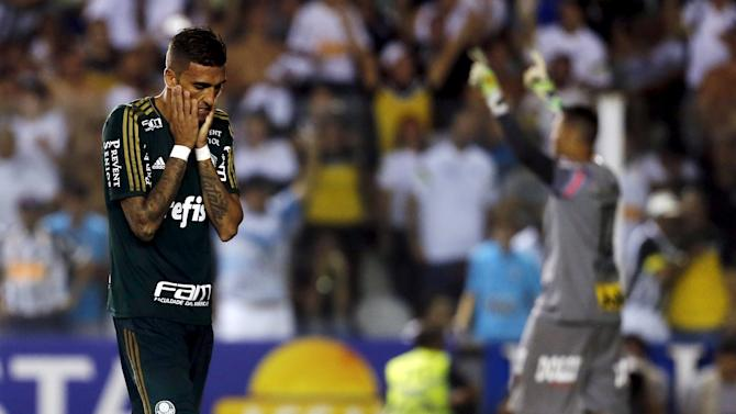 Cleiton Xavier of Palmeiras reacts after his penalty kick was saved by goalkeeper Vladimir of Santos during their Sao Paulo state championship final soccer match in Santos