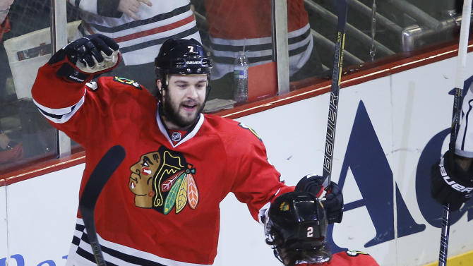 Chicago Blackhawks defenseman Brent Seabrook (7) celebrates with defenseman Duncan Keith (2) after scoring a goal against the Los Angeles Kings during the first period in Game 2 of the NHL hockey Stanley Cup Western Conference finals Sunday, June 2, 2013 in Chicago. (AP Photo/Charles Rex Arbogast)