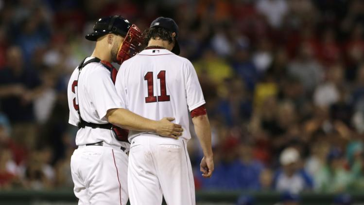 Boston Red Sox starting pitcher Clay Buchholz (11) talks with catcher David Ross before giving up a two-run single to Toronto Blue Jays' Ryan Goins during the fourth inning of a baseball game at Fenway Park in Boston, Monday, July 28, 2014. (AP Photo/Charles Krupa)