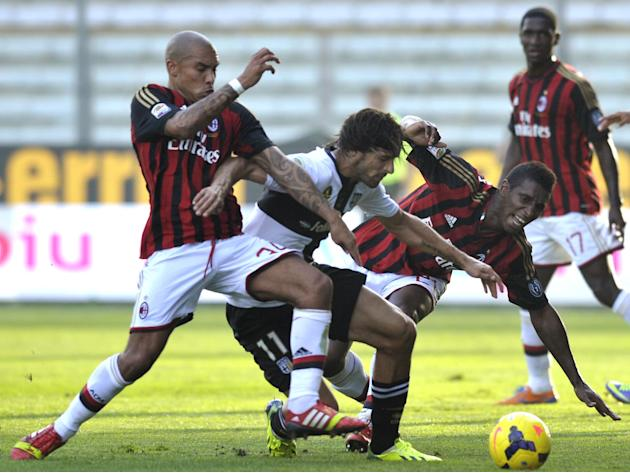 Parma's Carvalho Amauri, center, competes for the ball with AC Milan's Nigel De Jong of Netherlands, left, and Kevin Constant of Guinea, during their Serie A soccer match at Parma's Tardini stadium, I
