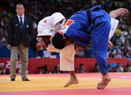 Russia's Arsen Galstyan (white) competes with Japan's Hiroaki Hiraoka at the London 2012 Olympic Games. Galstyan upset the top two seeds, including a 40-second final triumph over Hiraoka, to win the men's under-60kg judo gold medal