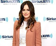 Rachel Bilson shows off her sense of style in a white lace frock topped with a salmon colored jacket and sky-high Mary Jane pumps