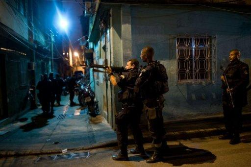 Brazilian BOPE police elite unit personnel patrol in Rio de Janeiro, Brazil, on March 3, 2013