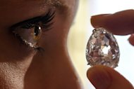 A picture taken on May 10 shows a model posing with the Beau Sancy diamond during a Sotheby's auction press preview in Geneva. The gem was bought by an anonymous bidder for $9.7 mn