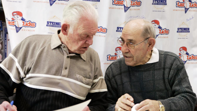 FILE- In this Feb. 18, 2006, file photo, former New York Yankees pitcher Don Larsen, left, talks with catcher Yogi Berra as they sign autographs in Huntington, N.Y. The baseball jersey worn by Larsen when he pitched the only perfect game in World Series history will soon be available for auction by Steiner Sports Memorabilia who will run the auction October through December 2012. (AP Photo/Ed Betz, File)