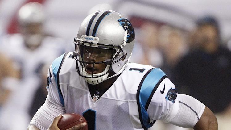 Carolina Panthers quarterback Cam Newton runs for a score during the second half of an NFL football game against the Atlanta Falcons on Sunday, Sept. 30, 2012, in Atlanta. (AP Photo/John Bazemore)