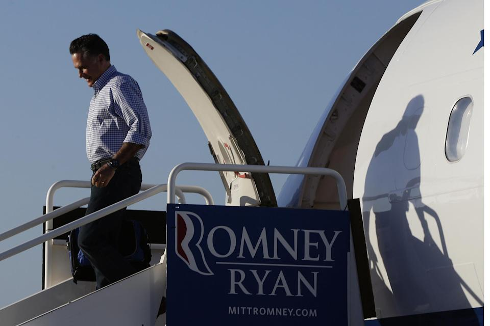 Republican presidential candidate and former Massachusetts Gov. Mitt Romney steps off his campaign plane in Tampa, Fla., Tuesday, Oct. 30, 2012. (AP Photo/Charles Dharapak)