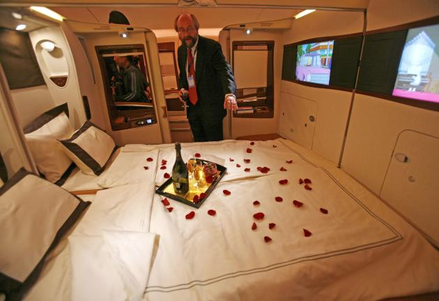 File photo of a journalist inspecting a double bed first class suite during a media tour of the Airbus A380 superjumbo after it landed at Singapore's Changi Airport