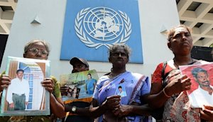 Sri Lankans hold portraits of missing relatives outside …