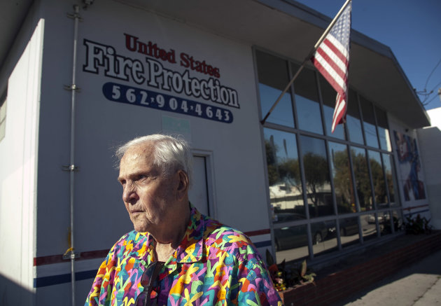 Business owner Dean Wright, 82, pauses outside his neighbor&#39;s family-owned business, United States Fire Protection Services, in Downey, Calif. Thursday, Oct. 25, 2012. A gunman killed three people and injured two, including a 13-year-old boy, Wednesday in two separate attacks on a family at their business, United States Fire Protection Services and nearby residence. Police say the five family members who were shot had been targeted by the gunman. (AP Photo/Damian Dovarganes)