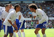 Steven Pienaar, left, and Marouane Fellaini, right, were on target for Everton