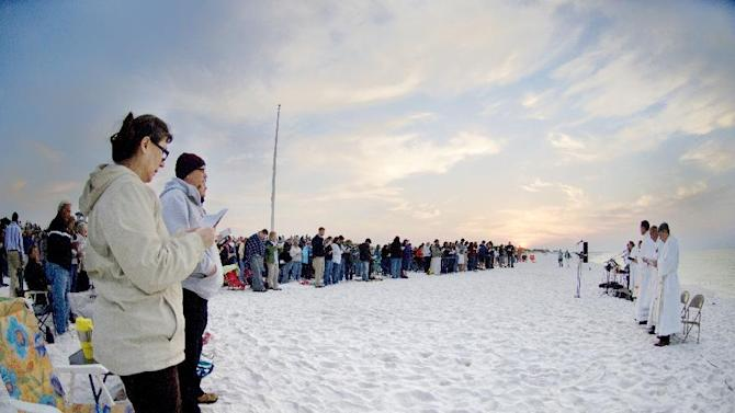 Zora Orness, left, was among hundreds of people who turned out Sunday morning to attend the 38th Annual Easter Sunrise Service on Okaloosa Island near Fort Walton Beach, Fla., Sunday, April 8, 2012. The annual event is hosted by four area Lutheran churches and is held along the shore of the Gulf of Mexico in this community in the Florida panhandle. (AP Photo/Northwest Florida Daily News, Devon Ravine)