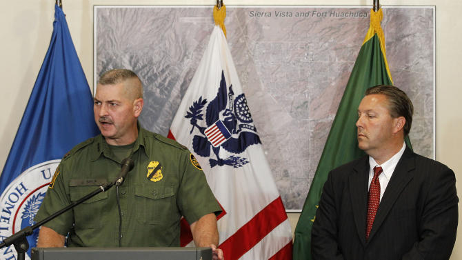 Hours after a U.S. Border Patrol agent was shot and killed, and one other was shot and injured, Jeffrey Self, left, U.S. Border Protection Joint Field Command Arizona, issues a statement and James Turgal, FBI Special Agent in Charge Phoenix, listens during a news conference at the U.S. Customs and Border Protection Brian A. Terry Border Patrol Station Tuesday, Oct. 2, 2012, in Bisbee, Ariz.(AP Photo/Ross D. Franklin)