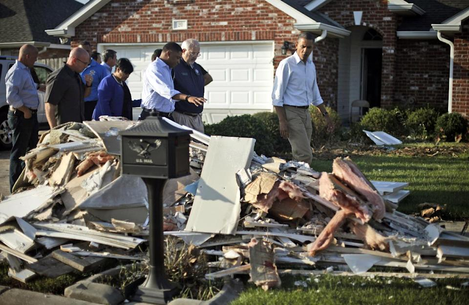 President Barack Obama walks past debris on the sidewalks as he tours the Bridgewood neighborhood in LaPlace, La., in the Saint John the Baptist Parish, with local officials to survey the ongoing response and recovery efforts to Hurricane Isaac, Monday, Sept. 3, 2012. (AP Photo/Pablo Martinez Monsivais)