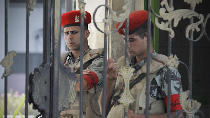 """Egyptian soldiers stand guard outside the Maadi military hospital where former president Hosni Mubarak was transferred and is currently on life support after suffering a stroke in prison in Cairo, Egypt, Wednesday, June 20, 2012. The 84-year-old Mubarak suffered a """"fast deterioration of his health"""" and his heart stopped beating, the state news agency MENA and security officials said. (AP Photo/Amr Nabil)"""