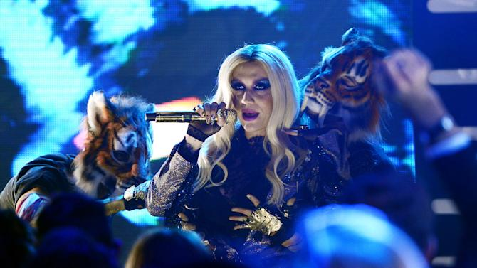 """IMAGE DISTRIBUTED FOR MTV - Ke$ha performs during """"MTV's Club NYE 2013"""" at the MTV Times Square Studios on Monday, Dec. 31, 2012 in New York.(Photo by Scott Gries/Invision for MTV/AP Images)"""