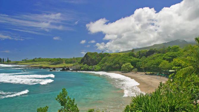 """FILE - This undated file photo provided by Ron Dahlquist for the Maui Visitors Bureau shows Hamoa Beach in Maui, Hawaii. Hamoa Beach is fifth on the 2012 list of Top 10 Beaches produced annually by coastal expert Stephen P. Leatherman, also known as """"Dr. Beach,"""" director of Florida International University's Laboratory for Coastal Research.   (AP Photo/MVB, Ron Dahlquist)   MANDATORY CREDIT: MVB/RON DAHLQUIST. FOR EDITORIAL USE ONLY, NO SALES, ONE-TIME USE ONLY, NO ARCHIVES, FOR USE ONLY WITH TRAVEL STORY ON BEST BEACHES."""