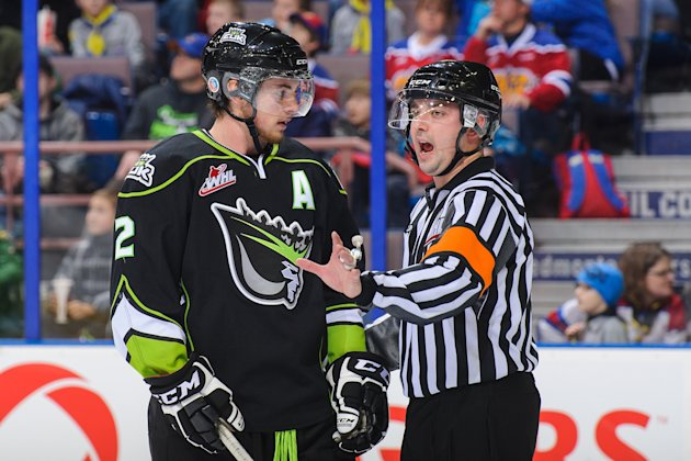 Cody Corbett #2 of the Edmonton Oil Kings discusses a call with an official between play against the Calgary Hitmen. (Photo by Derek Leung/Getty Image...