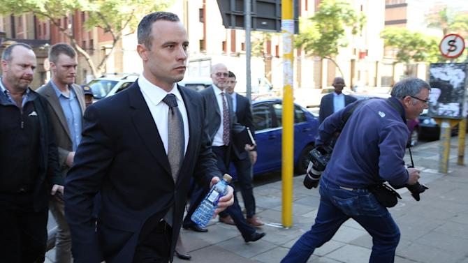 Oscar Pistorius leaves the high court in Pretoria, South Africa, Wednesday, May 14, 2014. Pistorius is charged with murder for the shooting death of his girlfriend, Reeva Steenkamp, on Valentines Day in 2013. A judge ruled on Wednesday, that Pistorius be sent for psychiatric observation. (AP Photo/Themba Hadebe)