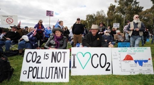 <p>This file photo shows anti-carbon tax protesters, known as The Convoy of No Confidence, in front of the Parliament House in Canberra, in 2011. Australia on Sunday introduced the controversial carbon tax in a bid to tackle climate change, with Prime Minister Julia Gillard hailing the move amid opposition warnings it will stifle industry.</p>