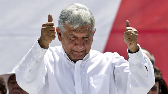 Andres Manuel Lopez Obrador, former presidential candidate of the Democratic Revolution Party (PRD), gives a thumbs up to his supporters at Mexico City's main plaza, the Zocalo, Sunday, Sept. 9, 2012. Lopez Obrador, who led Mexico's main leftist party in the past two presidential elections announced Sunday he is leaving it behind and may start a new party, throwing uncertainty over the future of the nation's political left. (AP Photo/Christian Palma)