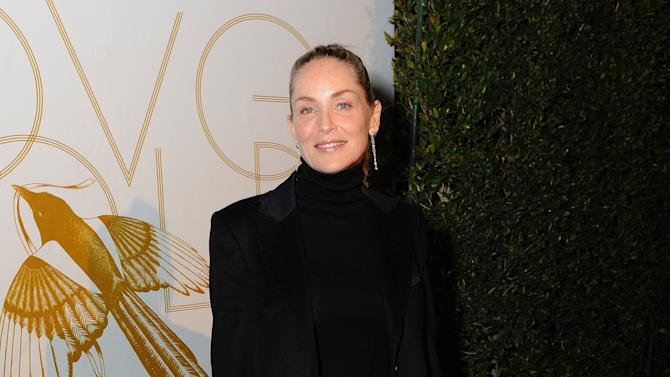 """Sharon Stone attends LoveGold/EJAF Celebrate """"How to Survive a Plague"""" at Chateau Marmont on February 22, 2013 in Los Angeles. (Photo by Jordan Strauss/Invision for LoveGold/AP Images)"""