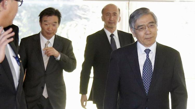 Newly appointed Bank of Japan Gov. Haruhiko Kuroda, right, and Deputy Governors, Hiroshi Nakaso, center, and Kikuo Iwata, leave the prime minister's official residence after meeting with Prime Minister Shinzo Abe in Tokyo Thursday, March 21, 2013. Kuroda, a finance ministry veteran and former president of the Asian Development Bank, reaffirmed his pledge to prioritize getting Japan's economy out of its long bout of deflation. (AP Photo/Kyodo News) JAPAN OUT, MANDATORY CREDIT, NO LICENSING IN CHINA, HONG KONG, JAPAN, SOUTH KOREA AND FRANCE