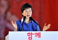 The ruling party candidate in South Korea&#39;s presidential election apologised Monday for human rights abuses during the repressive rule of her late father, military strongman Park Chung-Hee. Park Geun-Hye (pictured in August) offered her &quot;sincere apologies to those who suffered and were wounded during this period, and to their families.&quot;